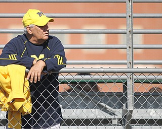 "Nikos Frazier | The Vindicator..Mike Delaquila, of Warren, watches as Michigan Head Coach, Jim Harbaugh coaches the Warren Harding Elite Camp. Delaquila, is a 30 year season ticket holder for Michigan  Football and came to see ""Jimmy and the crew."""