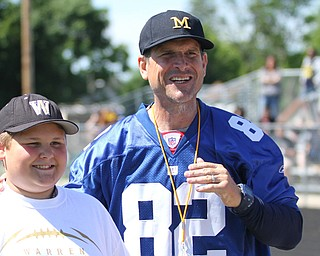 Nikos Frazier | The Vindicator..Jim Harbaugh, Michigan  Football Head Coach, poses with Anthony Campbell-Hauggins, 11, of Warren.