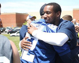 Nikos Frazier | The Vindicator..Jim Harbaugh(left), Michigan  Head Coach, embraces Mario Manningham(right), after the Warren Harding Elite Camp. Manningham, originally from Warren, played for Harbaugh and the 49ers in 2012 and 2013 as well as Michigan State in college.