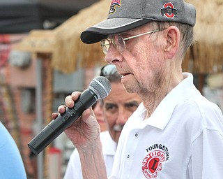 William D. Lewis/The Vindicator The 55 th annual Turtle Races sponsored by the Youngstown Lions Club were held in Lowellville Monday June, 20,2016. Parker McHenry, a longtime Lions member calls the races. He hasparticipated in 40 of the events.