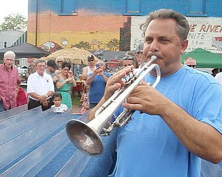 William D. Lewis/The Vindicator The 55 th annual Turtle Races sponsored by the Youngstown Lions Club were held in Lowellville Monday June, 20,2016. Trumpeter Joe Ballone of Lowellville cals the turtles to the start
