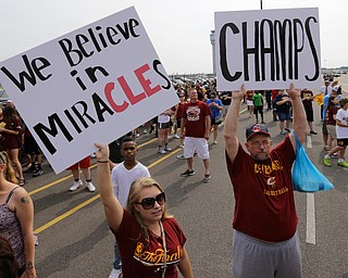 Cleveland Cavaliers fans hold up signs before the arrival of the team in Cleveland, Monday, June 20, 2016. Lebron James came home with the trophy he promised, and the championship Cleveland has coveted for 52 years. The NBA superstar, born and raised in nearby Akron, stepped off a plane Monday and hoisted the shiny Larry O'Brien Trophy as more than 10,000 fans celebrated the city's first title since 1964. (AP Photo/Tony Dejak)