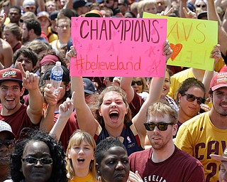Cleveland Cavaliers fans cheer as they wait for the team's arrival in Clevleand, Monday, June 20, 2016. Lebron James came home with the trophy he promised, and the championship Cleveland has coveted for 52 years. The NBA superstar, born and raised in nearby Akron, stepped off a plane Monday and hoisted the shiny Larry O'Brien Trophy as more than 10,000 fans celebrated the city's first title since 1964. (AP Photo/Tony Dejak)