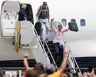 NBA champion Cleveland Cavaliers' Timofey Mozgov, right, celebrates as he arrives at the airport Monday, June 20, 2016, in Cleveland.  (AP Photo/John Minchillo)