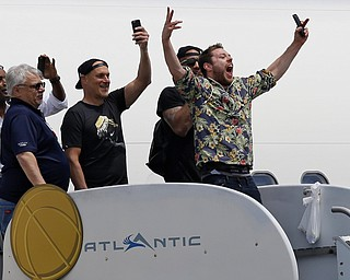 Cleveland Cavaliers' Matthew Dellavedova, from Australia, yells to fans after arriving in Cleveland, Monday, June 20, 2016. The Cavaliers defeated Golden State in Game 7 of the NBA Finals on Sunday in Oakland, Calif.(AP Photo/Tony Dejak)