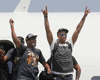 NBA champion Cleveland Cavaliers' Dahntay Jones, right, and Mo Williams celebrate as they arrive at the airport Monday, June 20, 2016, in Cleveland. (AP Photo/John Minchillo)