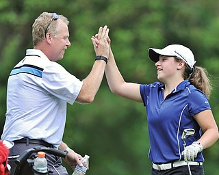 Jeff Lange | The Vindicator  FRI, JUN 24. 2016 - Ken Cerimele of Canfield (left) congratulates his daughter Gillian after she defeated Mathews' Emily Koehler in a tie breaker during Friday's Greatest Golfer of the Valley Junior competition at Tam O'Shanter Golf Course in Hermitage, Pa.
