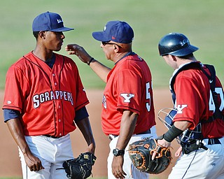 Jeff Lange | The Vindicator  SAT, JUN 25, 2016 - Scrappers' starting pitcher Luis Jimenez (left) has a meeting at the mound with manager Edwin Rodriguez and catcher Logan Lee early in Saturday's game against Batavia.