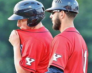 Jeff Lange | The Vindicator  SAT, JUN 25, 2016 - Scrappers Nate Winfrey (left) listens as Juan Gomes (11) gives instruction after Winfrey was walked in the fourth inning of a baseball game against Batavia Saturday night at Eastwood Field in Niles.