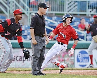 Jeff Lange | The Vindicator  SAT, JUN 25, 2016 - Scrappers Alexis Pantoja (right) looks to right field after hitting a 2 RBI line drive triple to right field in the bottom of the fourth inning as Batavia's Garvis Lara (34) looks on. Mahoning Valley scored 6 in the fourth inning to make the score 9-4