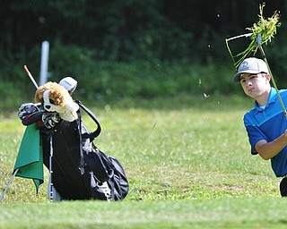 Michael Butch of Ursuline watches his shot from the rough during Wednesday's 2016 Flynn Auto Group Junior Greatest Golfer of the Valley tournament Wednesday at Mill Creek South Course. Butch placed U-17...--Jeff Lange | The Vindicator  WED, JUN 29, 2016