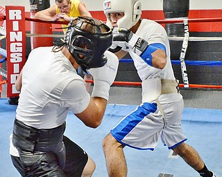Jeff Lange | The Vindicator  SAT, JUL 9, 2016 - Popo Salinas (right) looks to jab opponent Jake Giuriceo during a sparring match while training at the gym on Market Street on Saturday, July 9, 2016.