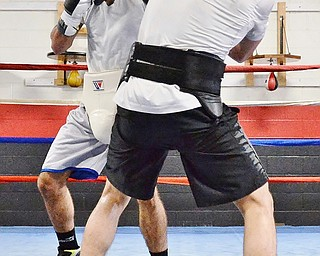 Jeff Lange | The Vindicator  SAT, JUL 9, 2016 - Popo Salinas (left) and Jake Giuriceo exchange blows during a sparring match while training at the gym on Market Street on Saturday, July 9, 2016.