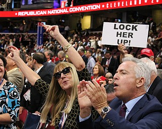Other state delegates dancing on the floor, with a sign aimed at Hillary Clinton in the background..