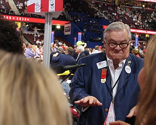 Jim Dicke, an at-large Ohio delegate at the Republican National Convention, dances to start the Wednesday evening session..