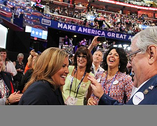 Lt. Gov. Mary Taylor and other members of the Ohio delegation to the Republican National Convention dance during the start of WednesdayÕs evening session..