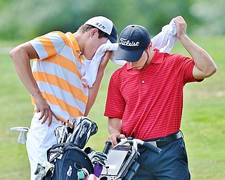 Jeff Lange | The Vindicator  FRI, JUL 22, 2016 - Cade Kreps of Boardman (left) uses Michael Melewski's towel to wipe his brow in between the second and third hole during the Greatest Golfer of the Valley Junior finals held at Avalon at Squaw Creek Friday afternoon.