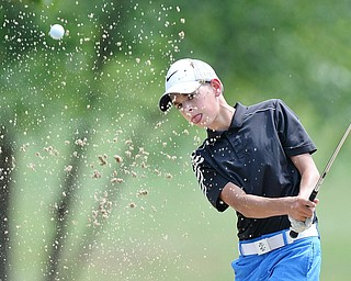 Jeff Lange | The Vindicator  FRI, JUL 22, 2016 - Dean Austalosh of Campbell blasts out of the No. 3 bunker during the Greatest Golfer of the Valley Junior finals held at Avalon at Squaw Creek on Friday.