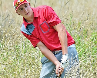 Jeff Lange | The Vindicator  FRI, JUL 22, 2016 - Bryan Kordupel of Boardman punches his way out of the tall weeds on the fourth hole at Avalon at Squaw Creek during Friday's Greatest Golfer of the Valley Junior finals.