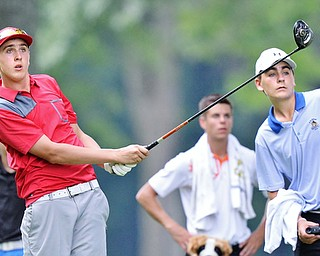Jeff Lange | The Vindicator  FRI, JUL 22, 2016 - Boardman's Bryan Kordupel (left) and caddy Tyler Harbert of Springfield watch Kordupel's drive from the No. 5 tee box during Friday's Greatest Golfer of the Valley Junior finals held at Avalon at Squaw Creek.