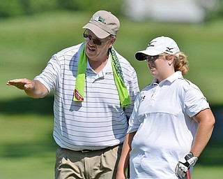 Jeff Lange | The Vindicator  SAT, JULY 23, 2016 - Erika Hoover of New Wilmington (right) and her father Terry read the No. 10 green during Saturday's Greatest Golfer of the Valley Junior finals held at Avalon Lakes in Vienna.