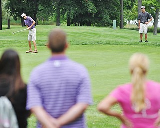 Jeff Lange | The Vindicator  SUN, AUG 21, 2016 - Brandon Pluchinsky watches his putt travel to hole No. 17 as spectators look on during the final round of the 2016 Farmers Bank Greatest Golfer of the Valley competition held at the Lake Club in Poland, Sunday, Aug. 21, 2016.