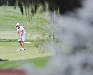 Jeff Lange | The Vindicator  SUN, AUG 21, 2016 - Marilyn Woods watches her putt to hole No. 17 during the final round of the 2016 Farmers Bank Greatest Golfer of the Valley competition held at the Lake Club in Poland, Sunday, Aug. 21, 2016.
