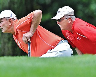 Jeff Lange | The Vindicator  SUN, AUG 21, 2016 - Chuck Montgomery (left) and his caddie John Dunch read the No. 16 green during the final round of the 2016 Farmers Bank Greatest Golfer of the Valley competition held at the Lake Club in Poland, Sunday, Aug. 21, 2016.