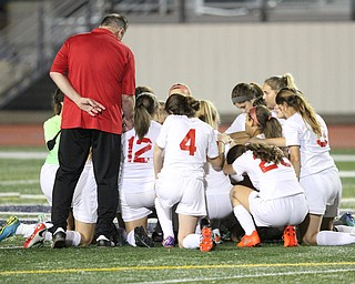Solon, Ohio: Tuesday, Nov. 1, 2016..Cardinal Mooney players say a prayer before taking on Gilmour Academy at the Division III girls soccer regional semifinal at Stewart Field in Solon, Ohio on Tuesday, Nov. 1, 2016...(Nikos Frazier | The Vindicator
