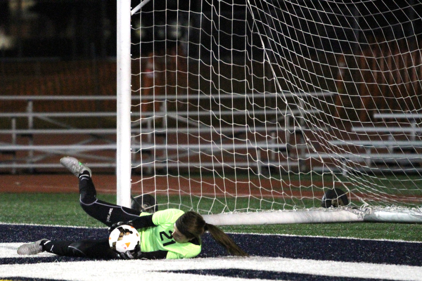 Solon, Ohio: Tuesday, Nov. 1, 2016..Mooney goalie, Skyler Huda(21) saves a goal attempt in the first half as Cardinal Mooney High School takes on Gilmour Academy at the Division III girls soccer regional semifinal at Stewart Field in Solon, Ohio on Tuesday, Nov. 1, 2016...(Nikos Frazier   The Vindicator