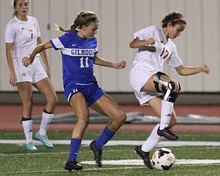 Solon, Ohio: Tuesday, Nov. 1, 2016..Mooney's Lizzie Philibin(17) dribbles around Gilmour's Annie Greene(11) in the first half as Cardinal Mooney High School takes on Gilmour Academy at the Division III girls soccer regional semifinal at Stewart Field in Solon, Ohio on Tuesday, Nov. 1, 2016...(Nikos Frazier | The Vindicator