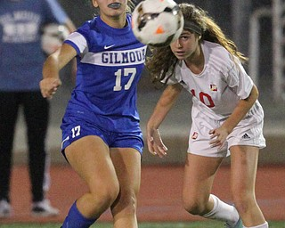 Solon, Ohio: Tuesday, Nov. 1, 2016..Gilmour's Allie Mullee(17) and Mooney's Carolyn Kay(10) watch the ball after it is kicked away after they battled over it in the first half as Cardinal Mooney High School takes on Gilmour Academy at the Division III girls soccer regional semifinal at Stewart Field in Solon, Ohio on Tuesday, Nov. 1, 2016...(Nikos Frazier | The Vindicator