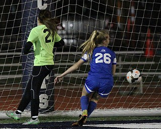 Solon, Ohio: Tuesday, Nov. 1, 2016..Gilmour's Allie Breen(26) scores a goal around Mooney goalie, Skyler Huda(21) in the second half as Cardinal Mooney High School takes on Gilmour Academy at the Division III girls soccer regional semifinal at Stewart Field in Solon, Ohio on Tuesday, Nov. 1, 2016...(Nikos Frazier | The Vindicator