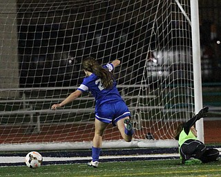 Solon, Ohio: Tuesday, Nov. 1, 2016..Gilmour's Cora Grunden(22) scores a goal around Mooney goalie, Skyler Huda(21) in the second half as Cardinal Mooney High School takes on Gilmour Academy at the Division III girls soccer regional semifinal at Stewart Field in Solon, Ohio on Tuesday, Nov. 1, 2016...(Nikos Frazier | The Vindicator