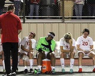 Solon, Ohio: Tuesday, Nov. 1, 2016..Mooney Head Coach, Frank Sikich talks with his players after Cardinal Mooney High School fell to Gilmour Academy, 7-1, at the Division III girls soccer regional semifinal at Stewart Field in Solon, Ohio on Tuesday, Nov. 1, 2016...(bench from right) Nicole Rotunnoi(20) Alexis Saunders(7), Trinity Adams(0), Lizzie Philibin(17)..(Nikos Frazier | The Vindicator