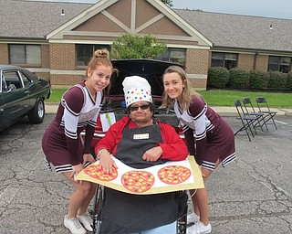 Neighbors | Alexis Bartolomucci.Two eighth-grade Boardman cheerleaders walked around with one of the Beeghly Oaks residents on .Oct. 1 during the first annual car show. Pictured, from left, are Kara Elisen, Audrey and Tara Pasvanis.