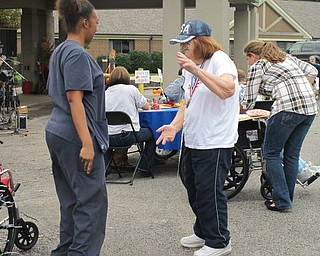 Neighbors | Alexis Bartolomucci.Beeghly Oaks resident, Esther Woodruff, danced with one of the faculty members at the first annual car show at Beeghly Oaks on Oct. 1.