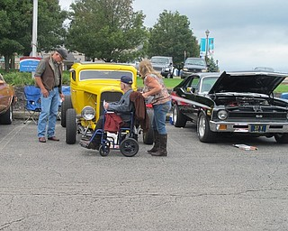 Neighbors | Alexis Bartolomucci.Residents and their families walked around the Beeghly Oaks parking lot on Oct. 1 to look at and learn about the different cars on display during the first annual car cruise at Beeghly Oaks.