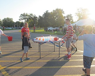 Neighbors | Alexis Bartolomucci.An Austintown student threw a ping pong ball into cups filled with water to win a prize during the Austintown Intermediate School and Elementary School pep rally on Oct. 6.