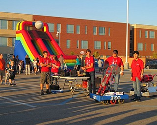Neighbors | Alexis Bartolomucci.Students from the Austintown Fitch High School Robotics Team brought their robots to the pep rally on Oct. 6 to show to the families who attended and use the robots to do a t-shirt toss.