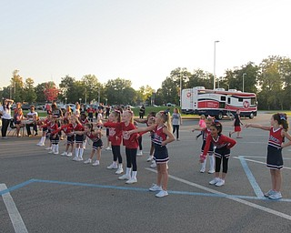 Neighbors | Alexis Bartolomucci.The Austintown Little Falcon cheerleaders put on a performance during the pep rally on Oct. 6 for the families who attended.