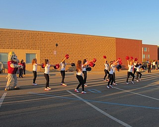 Neighbors | Alexis Bartolomucci.The Austintown Fitch High School dance line performed a dance with Scrappy from the Mahoning Valley Scrappers during the pep rally on Oct. 6.