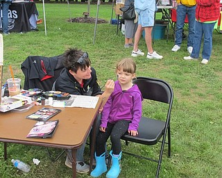 Neighbors | Alexis Bartolomucci.Madeline got her face painted during Oktoberfest at Boardman Park on Oct. 2.