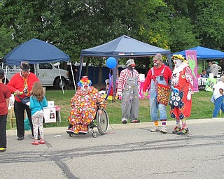Neighbors | Alexis Bartolomucci.Clowns at Oktoberfest at Boardman Park on Oct. 2 made balloon animals and entertained the families who attended the event.