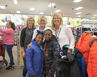 Neighbors | Alexis Bartolomucci.Members from the Boardman Lions Club stood with two children who came to pick out coats on Oct. 4 at Target. Pictured are, from left, (front) Ari'Ana and Elijah; (back) Jana Coffin, Kathy Collins and Joni Blase.