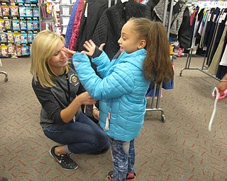 Neighbors | Alexis Bartolomucci.Boardman Lions Club member, Jana Coffin, helps Tavia Williams try on a coat at Target on Oct. 4 during the Coats for Kids project.