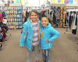 Neighbors | Alexis Bartolomucci.Joie Lynne Beebout and Tavia Williams tried on the new coats they picked out at Target during the Boardman Lions Club Coats for Kids project on Oct. 4.