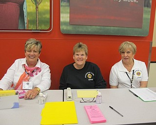 Neighbors | Alexis Bartolomucci.Boardman Lions Club members checked in Boardman residents who attended the Coats for Kids project event at Target on Oct. 4. Pictured are, from left, Kris Dailey, Betsy Koch and Jane Cornelius.