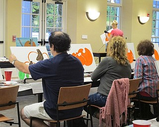 Neighbors | Alexis Bartolomucci.People painted pumpkin pictures during the painting event on Oct. 3 at the Poland library.