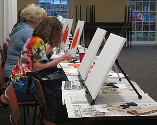 Neighbors | Alexis Bartolomucci.Guests worked on painting their pumpkin pictures at the painting event at the Poland library on Oct. 3.